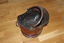 Mid Victorian helmet shaped coal bucket with good hand raised seam and a brass three piece set of fire irons.
