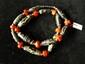 Collier ethnographique recomposé selon la tradition de perles de corail, perles gzi en pate de verre et métal argenté. Mongolie.