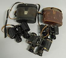 Three pairs of binoculars, to include Russian,