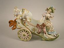 A late 19thC German porcelain carriage group, in