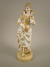 A late 19thC German bisque figure of a lady in