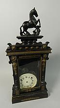 A late 19thC German ebonised mantel clock, with