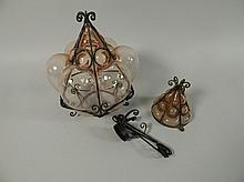 An Art Nouveau style wrought iron and pink glass