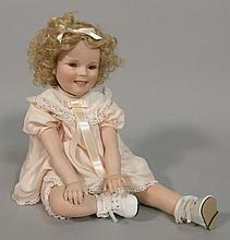 A modern Shirley Temple porcelain doll, made by