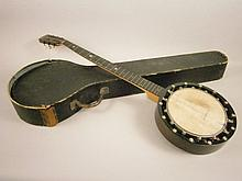 An early 20thC rosewood and satin birch banjo,