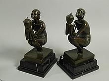 A pair of Art Deco style bronze figures, of