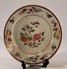 A late 18th Century Chinese export charger, of circular form, polychrome decorated with flowers in p