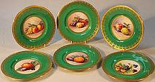 A set of six James Edwin Dean Minton cabinet plates, decorated with still life studies of mixed frui