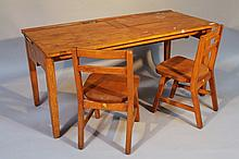 An early 20th Century double school desk, of rectangular form with metal ink wells and two chairs, p