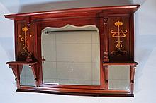An Edwardian mahogany over mantel mirror, the plain moulded D end top raised above baluster columns,
