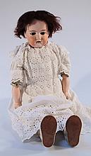 An Armand Marseille 370 5 DEP bisque headed doll, with brown wig, sleep eyes and open mouth showing