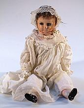 A mid-19th Century wax faced doll, with blonde hair, fixed glass eyes and moulded features, with a s