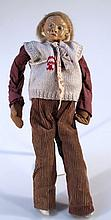 A mid 20th Century papier mache doll, with fixed features and articulated limbs, in corduroy trouser