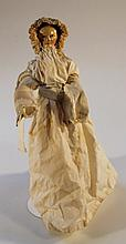 A Georgian painted wooden doll, with part articulated body wearing a dress and bonnet, 28cm high. (A