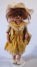 An early 20th Century Armand Marseille 3705/0 bisque headed doll, with blue eyes, open mouth showing