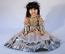 A 19th Century Armand Marseille 390 A.11.M bisque headed doll, with curled black mohair wig, fixed e