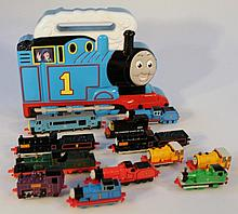 An Ertl Thomas the Tank Engine boxed die-cast set, comprising drains, tenders and carriages and a sm