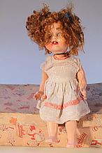 A mid-20th Century Roddy moulded doll, with knee walk action, turning head, sleep eyes, open mouth,