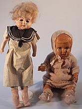 An early 20th Century semi plaster doll, with blonde wig, blue eyes with moulded closed mouth and an