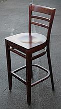 Ten various hardwood bar stools.