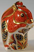 A Royal Crown Derby paperweight, of a squirrel, with gilt stopper, 10cm high.