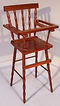 A mid-20th Century stained beech dolls high chair, of spindle back form on turned legs joined by pla
