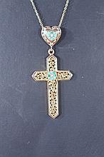 An early 20th Century crucifix, with heart shaped finial set with turquoise and seed pearls of part