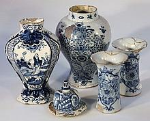 An English Delft blue and white vase, of shouldered form decorated with flowers on a circular foot,