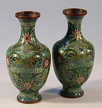 A pair of Chinese cloisonne vases, each of shouldered form decorated with flowers and scrolls in yel