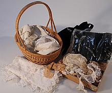 A quantity of 19th Century and later dolls linen, sashes, head scarves, material, trim, etc. (a quan