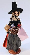 A late 18th or early 19th Century poured wax papier mache doll, with black bead glass eyes, painted