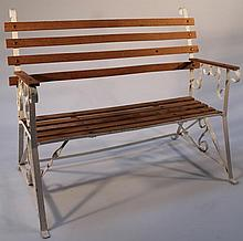 A 20th Century miniature beech and metal framed dolls bench, of slatted form on a shaped scroll base