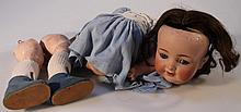 A 19th Century Simon and Halbig KR126/6 36 bisque headed doll, with tremble tongue, flirty eyes, met