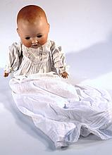 An early 20th Century Armand Marseille 851./6 bisque headed baby doll, with fixed eyes and open mout