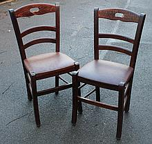 Eight various hardwood dining chairs, with over stuffed seats.