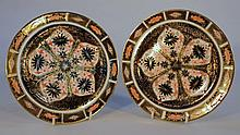 Two Royal Crown Derby Imari pattern side plates, each of circular form with printed marks beneath, 1