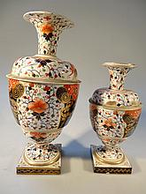 A graduated pair of early 19th Century Derby vases, each of cylindrical urn form with trumpet stems