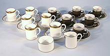 A 20th Century Susie Cooper bone china coffee set, comprising cans and saucers with a gilt outline a