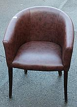 Eight brown leather tub chairs.