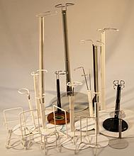 A quantity of various metal doll stands, of adjustable form, to include one 54cm high, others smalle