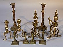 A quantity of brassware, candlesticks and fire dogs, various dimensions. (a quantity)