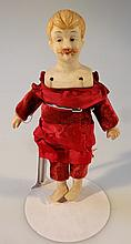 An 19th Century male bisque shoulder doll, with moulded hair and moustache with features in blue and