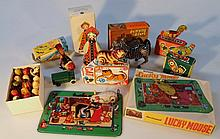 A quantity of clockwork and other toys, to include a mid-20th Century sparrow, 8cm wide, rolling cat