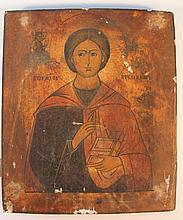 19th Century Russian School. Icon flanked by Russian script, polychrome decorated predominately in r