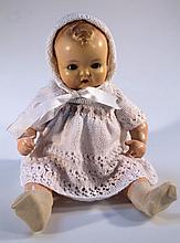 A mid-20thC moulded doll