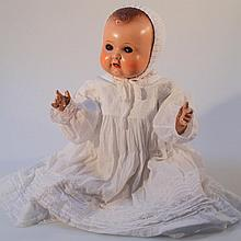 A mid-20thC 264K9 moulded composite doll