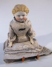 A mid 19thC porcelain doll