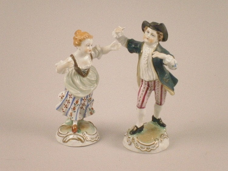 A pair of 20thC Dresden porcelain figures of a man