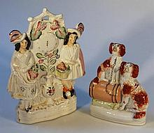 A 19th Century Staffordshire clock group, formed as two highland figures flanking a clock face and v