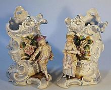A pair of late 19th Century Continental porcelain vases, of rococo design, polychrome decorated set